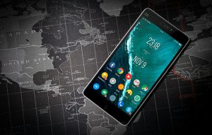 Smartphone on world map background