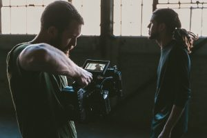 Cameraman and cast member filming a video